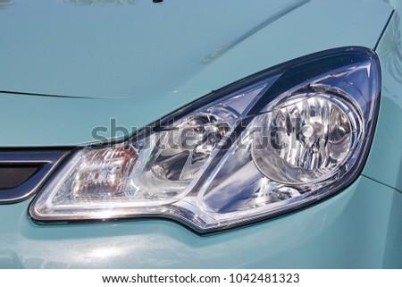 Car headlights in the sunlight #1042481323