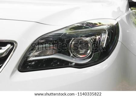 Car headlights. Luxury Headlights #1140335822