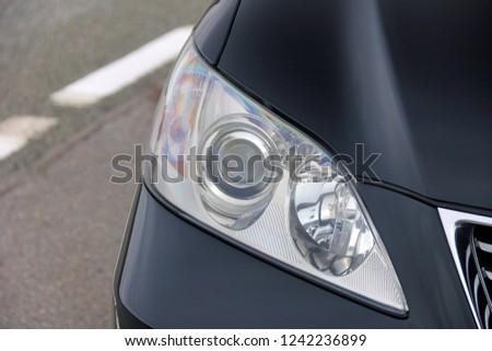 Car headlights. Luxury Headlights #1242236899