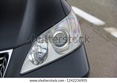 Car headlights. Luxury Headlights #1242236905
