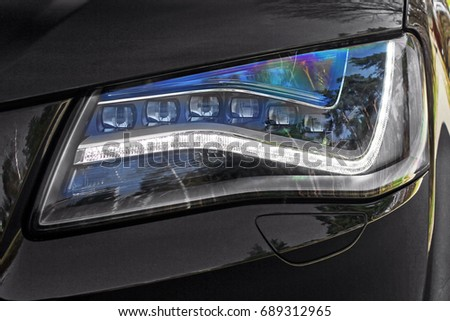 Car headlights. Luxury Headlights  #689312965