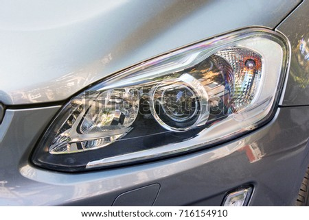 Car headlights. Luxury Headlights #716154910