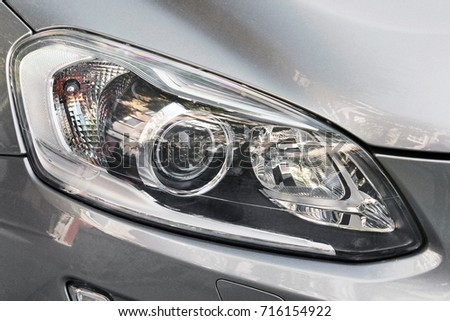Car headlights. Luxury Headlights #716154922