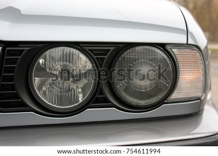 Car headlights. Luxury Headlights #754611994