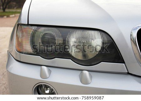 Car headlights. Luxury Headlights  #758959087