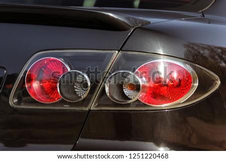 Car headlights. Luxury Headlights. Car #1251220468