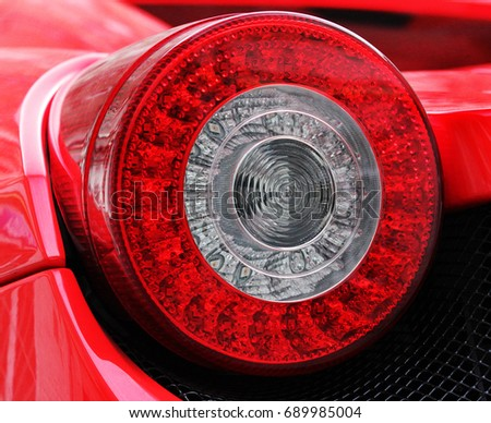 Car headlights. Luxury Headlights. Car. Red.  #689985004