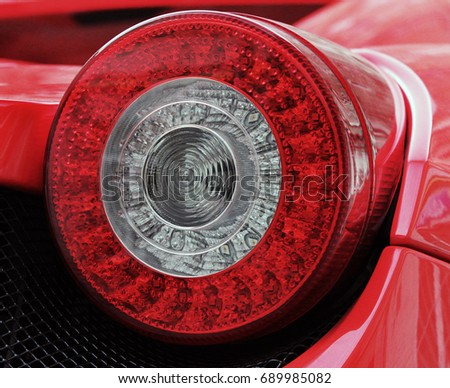 Car headlights. Luxury Headlights. Car. Red.  #689985082