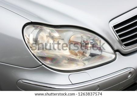 Car headlights. Luxury Headlights. Gray #1263837574