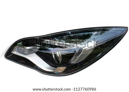 Car headlights. Luxury Headlights. White #1127760986