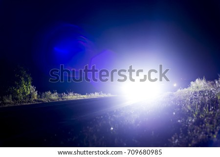 car headlights shine at night #709680985