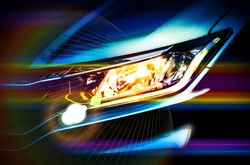 Car headlights with grain,flare effect and vivid color. Exterior detail. Car luxury concept.