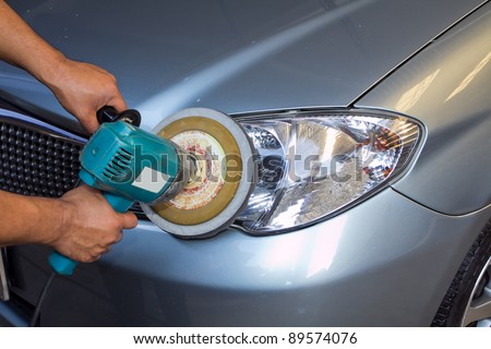 Car headlights with power buffer machine at service station - a series of CAR CARE images.