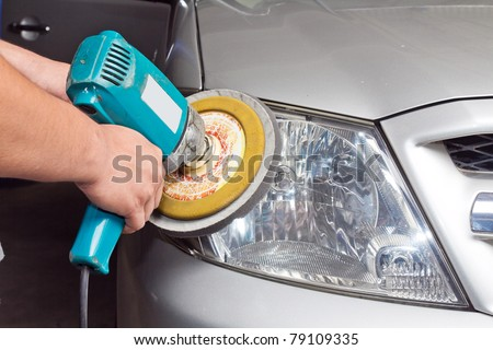 Car headlights with power buffer machine at service station - a series of CAR CARE images. closeup Useful as background for design-works.