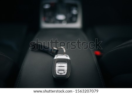 Photo of Car ignition key at the armrest