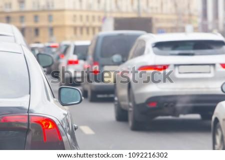 car in a big traffic jam. Back view. Blurred background. #1092216302
