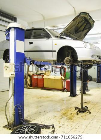 Car in a car repair station #711056275