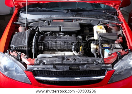 Car in auto repair shop. Service. Garage.