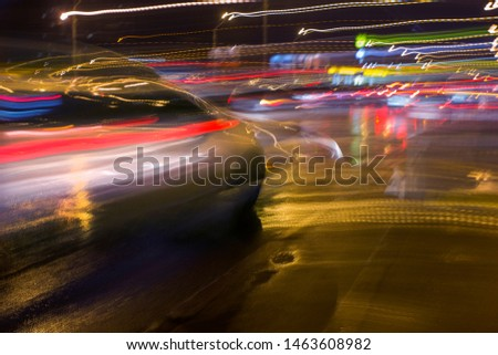car in fast motion on a deliberately blurred in motion background #1463608982