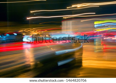 car in fast motion on a deliberately blurred in motion background #1464820706
