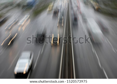 car in fast motion on a deliberately blurred in motion background #1520573975