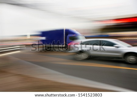 car in fast motion on a deliberately blurred in motion background #1541523803