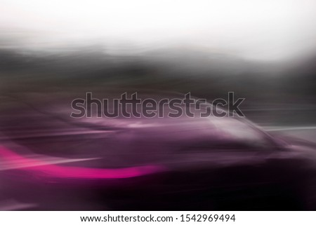 car in fast motion on a deliberately blurred in motion background #1542969494