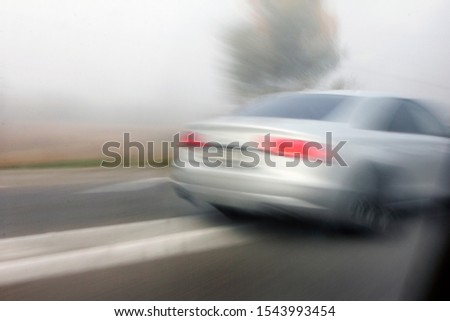 car in fast motion on a deliberately blurred in motion background #1543993454