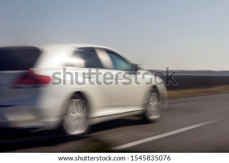 car in fast motion on a deliberately blurred in motion background #1545835076
