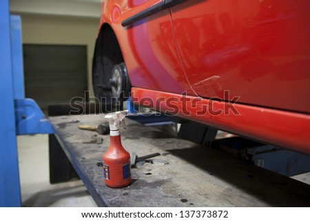 car in garage getting repaired / fixed #137373872