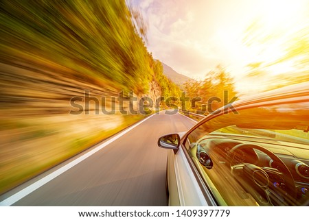 Car in motion blur driving in the Italian mountains #1409397779