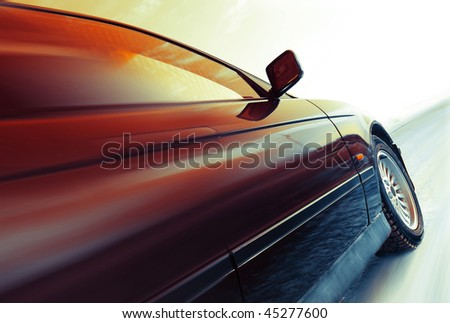 Car in motion on road