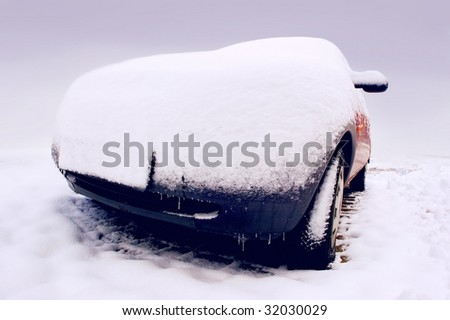 Car in snow in winter