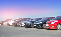 Car in stock for sale inventory. Car park outdoor in a row, automobile transportation dealer business concept