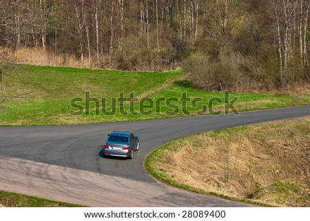 Car in t junction on a countryside road