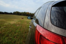 Car in the field forest sky