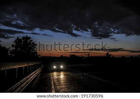 Car in the temporal at sunset