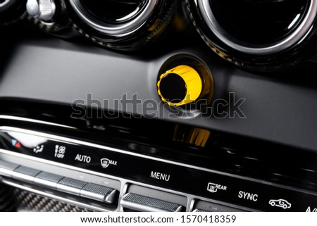 Car interior details, close up dashboard with buttons