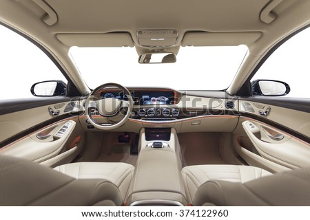Car interior luxury. Beige comfortable seats, steering wheel, dashboard, climate control, speedometer, display, wood decoration & orange ambient light