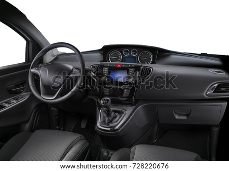 Car interior view with steering wheel and accessories