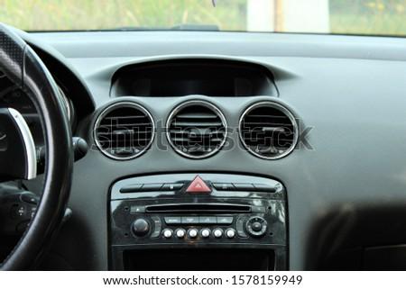 Car interior with audio equipment.