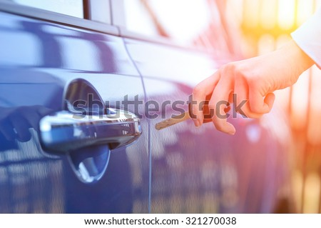 Car key in woman\'s hand