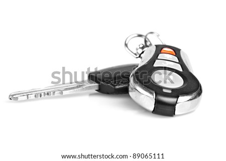 Car keys and remote alarm controller on a white background