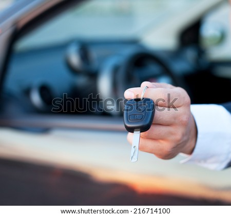 car keys in the hand, rent or buy car