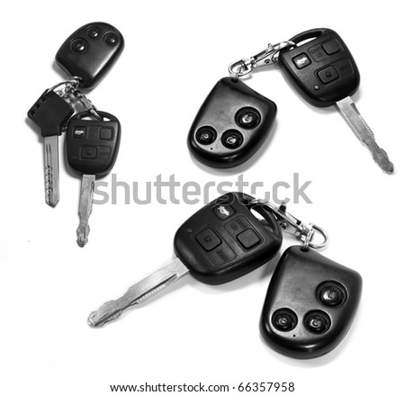 car keys with remotes on white background