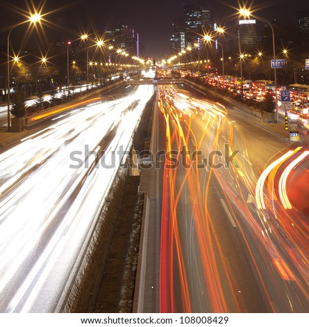 car lamp track at night on the road,beijing China - stock photo