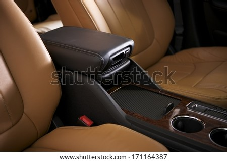 Car Leather Seats and Arm Rest. Modern Vehicle Interior Closeup.