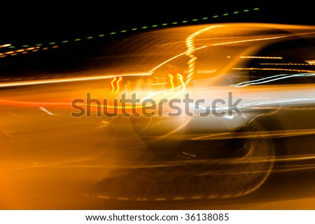 car light streaks on a city street at night