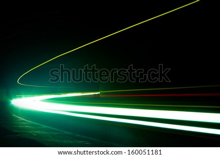 Car light trails. Art image . Long exposure photo taken in a tunne