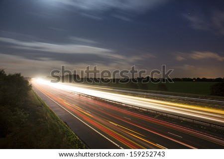 car light trails at night on highway
